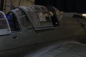 Geöffnetes Schiebedach mit kleinem Schiebefenster über dem Führersitz